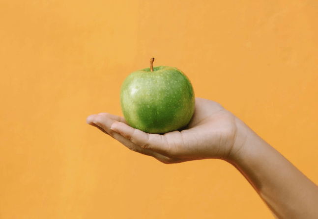 Green-apple-in-hand